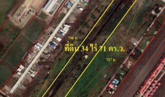 P295 ขายที่ดินแปลงเป็นรูปสี่เหลี่ยมสวย 34 ไร่ 71 ตร.ว. อำเภอไทรน้อย หน้าติดถนนหลักหลังติดคลอง ใกล้โรงเรียนกวดวิชา